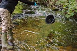 Sampling river water
